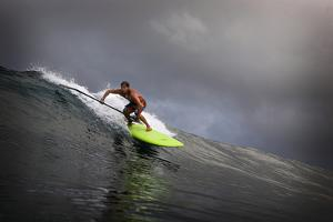 Riding a Big Swell on a Paddleboard in Waipi'O Bay by Chris Bickford