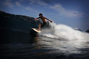 Surfing in Waipi'O Bay by Chris Bickford