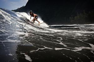 Surfing in Waipi'O Bay by Chris Bickford