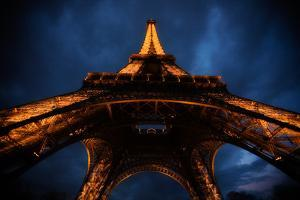 The Famous Eiffel Tower Illuminated at Night in Paris, France by Chris Bickford