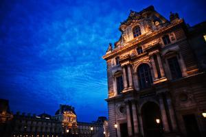 The Louvre Museum Illuminated at Night in Paris, France by Chris Bickford