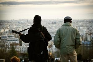 Two Men Look at the Paris Cityscape from the Basilica of the Sacred Heart by Chris Bickford