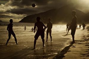 Young Men Play Soccer on Ipanema Beach in Rio De Janeiro by Chris Bickford
