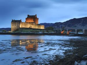 Eilean Donan (Eilean Donnan) Castle Illuminated, Dornie, Loch Duich, Highlands Region, Scotland by Chris Hepburn