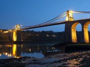 Menai Bridge Illuminated at Dusk, Gwynedd, Anglesey, North Wales, Wales, United Kingdom, Europe by Chris Hepburn