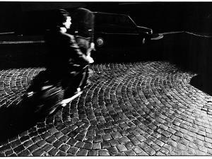 A Man on a Moped Speeding over Cobblestones in Rome by Chris Hill