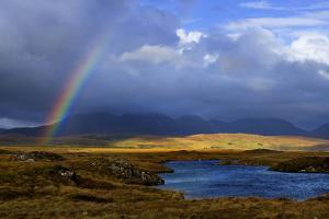 A Rainbow Touches Down at Roundstone Bog and the Twelve Pins in Connemara, Ireland by Chris Hill