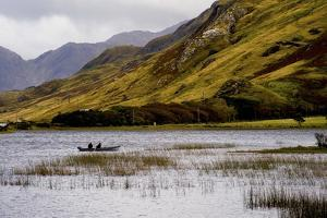 People Fishing in Kylemore Lough in Connemara, Ireland by Chris Hill
