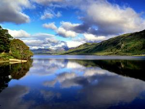 Reflections on Kylemore Middle Lake in Connemara by Chris Hill