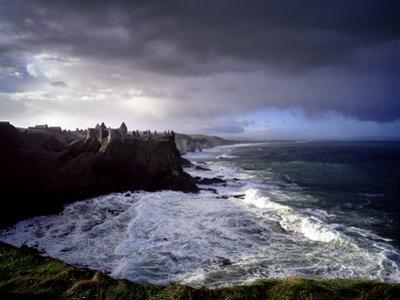 Ruins of Dunluce Castle on the north Antrim coast of Ireland. by Chris Hill