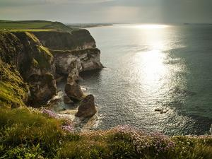 Sunlight Strikes White Rocks at Portrush on the North Coast of Northern Ireland by Chris Hill
