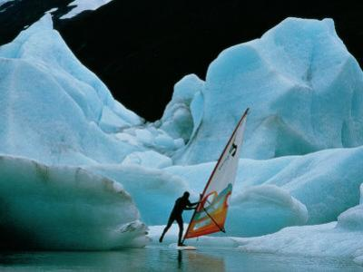 Windsurfer Practices His Sport Alongside Icebergs by Chris Johns