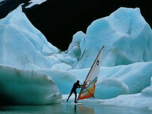 Windsurfer Practices His Sport Alongside Icebergs by Chris Johns