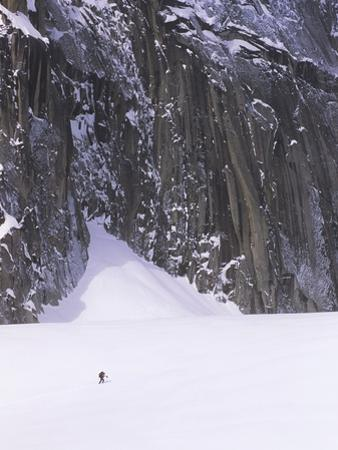 Backcountry Skier Underneath Snowpatch Spire, Bugaboos, British Columbia, Canada.