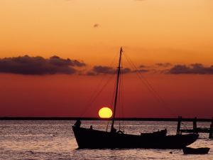 Sunset and Fishing Boats, Isla Mujeres, Mexico by Chris Rogers