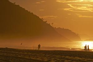 Brazil, Rio De Janeiro, Praia De Copacabana, Silhouette, People by Chris Seba