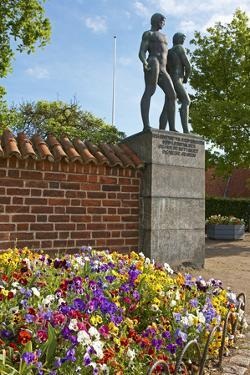 Denmark, Roskilde, Flowerbed, Pansies, Monument in Front of the Cathedral by Chris Seba