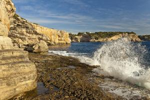 Europe, Spain, Majorca, Cala Llombards, Surf, Rocky Cliff, Rock Caves by Chris Seba