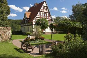 Germany, Hessen, Oberweser, Gieselwerder, Town Hall, Timber-Framed Building, Park, Benches by Chris Seba
