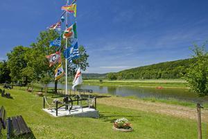 Germany, Weser Hills, Lower Saxony, Heinsen, Weser Shore, Flagstaff, Bench, Canoeist by Chris Seba