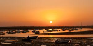 Portugal, Algarve, Ria Formosa Coast, Fishing Boats, Sunset by Chris Seba
