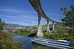 Portugal, Douro Valley, Rio Douro, Excursion Boat, Highway Bridge, Town Regua by Chris Seba
