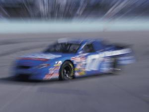 Auto Racing Action by Chris Trotman