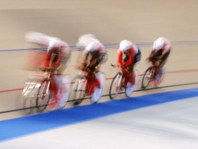 Blurred Action of Cycliing Team Onthe Track by Chris Trotman