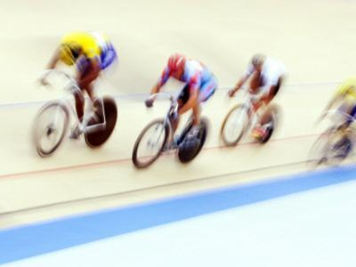 Blurred Action of Cyclist on the Track by Chris Trotman