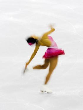 Blurred Action of Woman Figure Skater, Torino, Italy by Chris Trotman