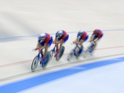 Cycling Team Competing on the Velodrome by Chris Trotman
