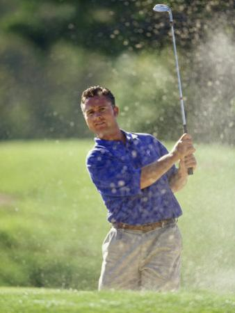 Male Golfer in Action by Chris Trotman