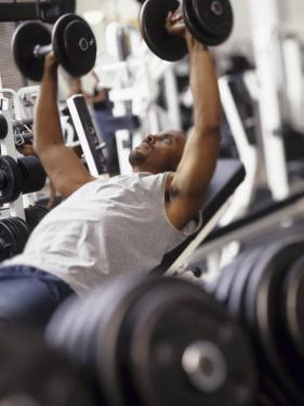 Male Working Out with Weights in a Health Club, Rutland, Vermont, USA by Chris Trotman