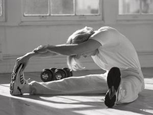 Man Stretching in Gym, New York, New York, USA by Chris Trotman