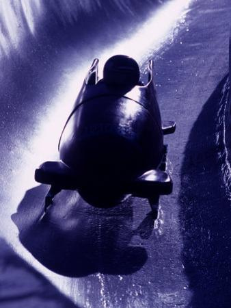 Silhouette of Bobsled in Action, Park City, Utah, USA by Chris Trotman