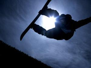 Silhouette of Male Snowboarder Flying over the Vert, Salt Lake City, Utah, USA by Chris Trotman