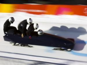 Start of a 4-Man Bobsled Team in Action, Torino, Italy by Chris Trotman