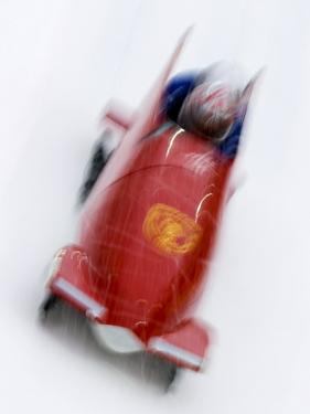 Two Man Bobsled in Action, Torino, Italy by Chris Trotman