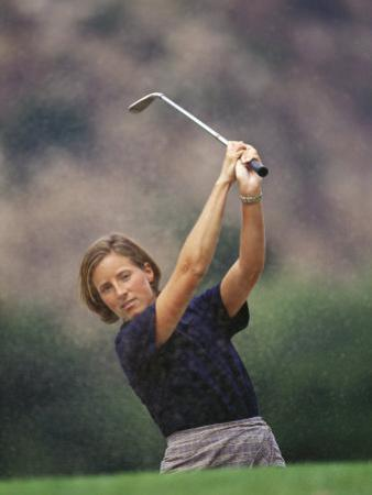 Woman Golfer in Action by Chris Trotman