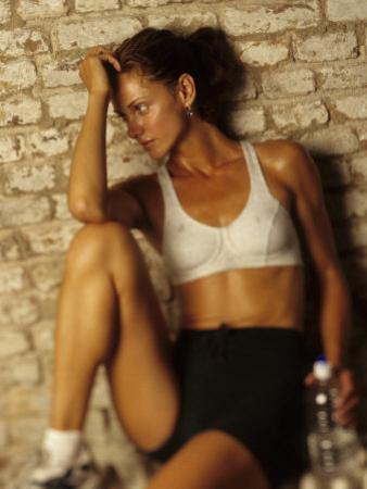 Woman Resting after Working Out, New York, New York, USA by Chris Trotman