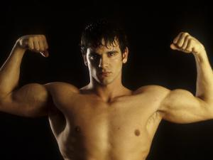 Young Adult Male Posing with Arms Flexed by Chris Trotman