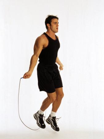 Young Man Working Out with Jump Rope by Chris Trotman