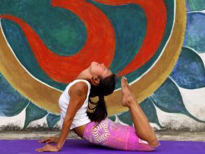 Female Astanga Yoga Practitioner in Backward Bending Posture by Christer Fredriksson