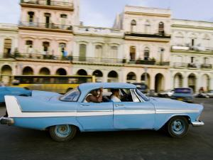Classic 1950's Car Driving Through Downtown by Christian Aslund