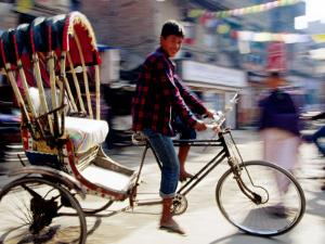 Cycle Rickshaw on Street, Kathmandu, Nepal by Christian Aslund