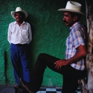 Men Standing in Street, Tequila, Mexico by Christian Aslund