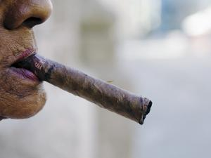 Profile of Cuban Woman Smoking Cigar in Vieja District by Christian Aslund