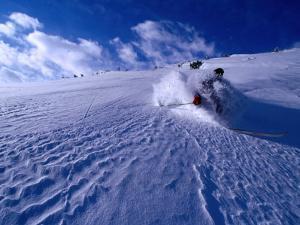 Skier Descending in Powder Snow, St. Anton Am Arlberg, Vorarlberg, Austria by Christian Aslund