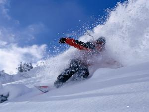 Snowboarder Carving Through Powder Snow, St. Anton Am Arlberg, Tirol, Austria by Christian Aslund