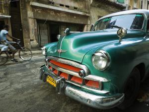 Vintage 1950's Car Parked on Street in Vedado District by Christian Aslund